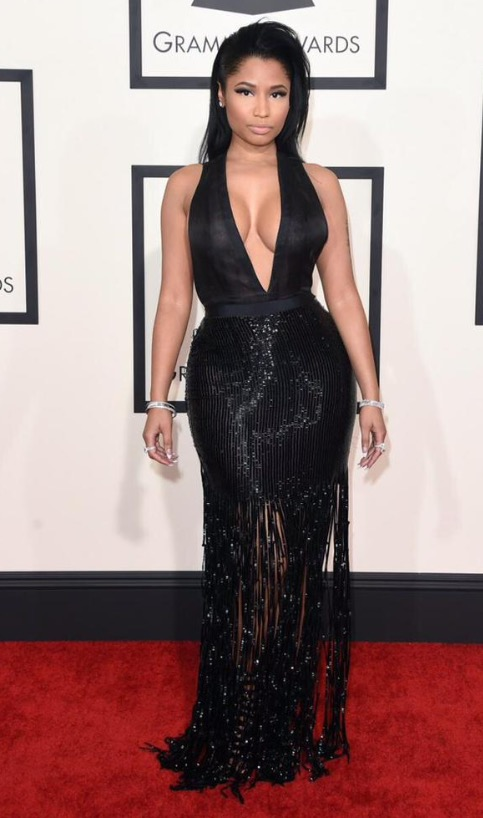 Nicki Minaj stunted on 'em in a black gown and a slicked coif. The buxom beauty proved why our anacondas don't! The pint-sized lyricist accentuated her bust with a low v-cut, and the tailoring on the dress was impeccable, showing off her curvy figure. Hopefully she will rack up at the 2016 Grammys.  **Lola's Notes** Nicki took a while to come into my heart (that was like, 4-5 years ago), but I must say, she looks absolutely stunning! I think she chose a perfect ensemble to accentuate her curves and maintained it with class. I'm also LOVING the natural makeup.