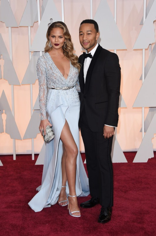 Chrissy Tiegen posed with Oscar winner hubby John Legend posed on the red carpet in Zuhair Murad spring 2015.  John's Trousers appear a little short and not sure about the square toed shoes. But Chrissy looked amazing.