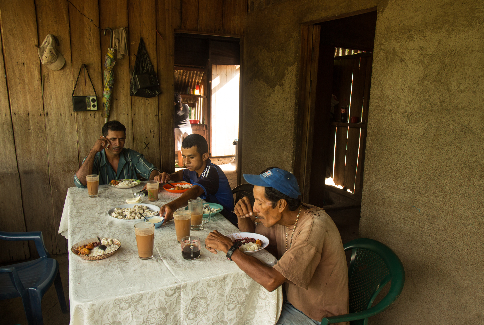 Javier Carmona eats breakfast with his sons Elder and Marcos the morning of a protest in nearby El Tule against the Nicaraguan Canal project and the Ley 840. Javier, a community leader and organizer with the Consejo Nacional which is fighting against the Ley 840 and the proposed Canal project by the government in order to protect their land. The proposed route and 20 km band of expropriation places his land under threat.