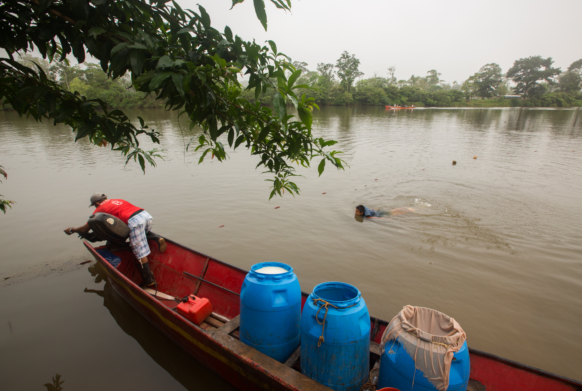 A man travels by boat to buy freshly produced milk from famers in the Paolo Bonito community on the Punta Gorda river in the early morning. If the Gran Canal project were to go forward, the river would be dredged as a shipping lane for cargo ships to pass from the Caribbean to the Pacific, removing farmer and indigenous communities.