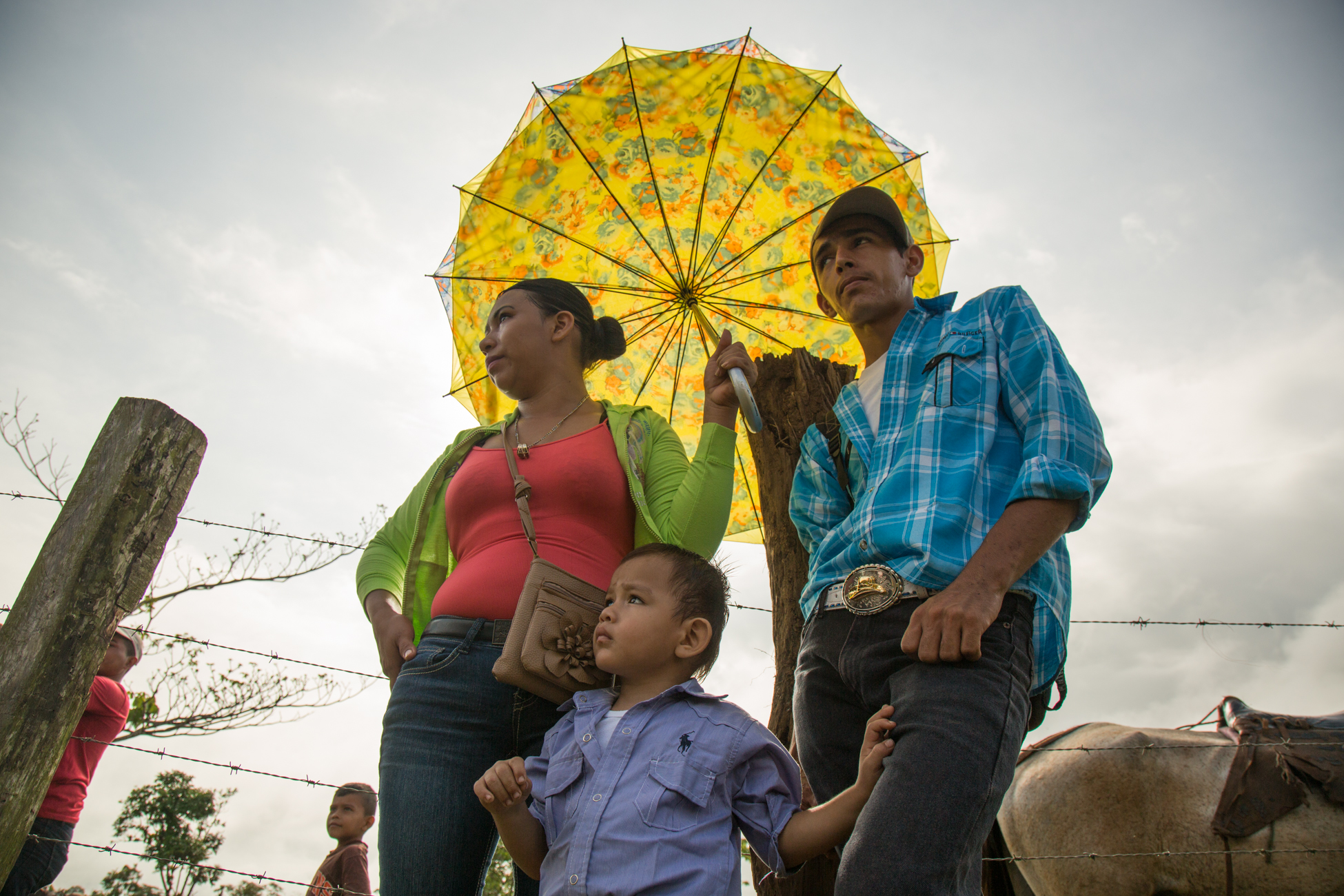 renor Jose Gonsales Rivas, 19 and his wife Irma Aguilar Garcia with their son at a market day in Palo Bonito where they sell goods on the banks of the Punta Gorda river in the early morning. If the Gran Canal project were to go forward, the river would be dredged as a shipping lane for cargo ships to pass from the Caribbean to the Pacific, removing farmer and indigenous communities.
