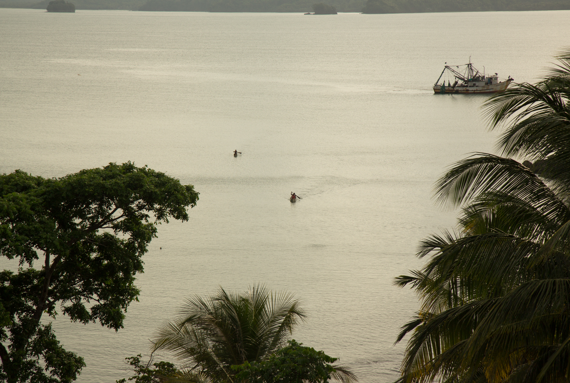 Fisherman paddle back to shore from a shrimping boat off the coast of Monkey point, an afro-kriol community on Nicaragua's southeastern Caribbean coast.