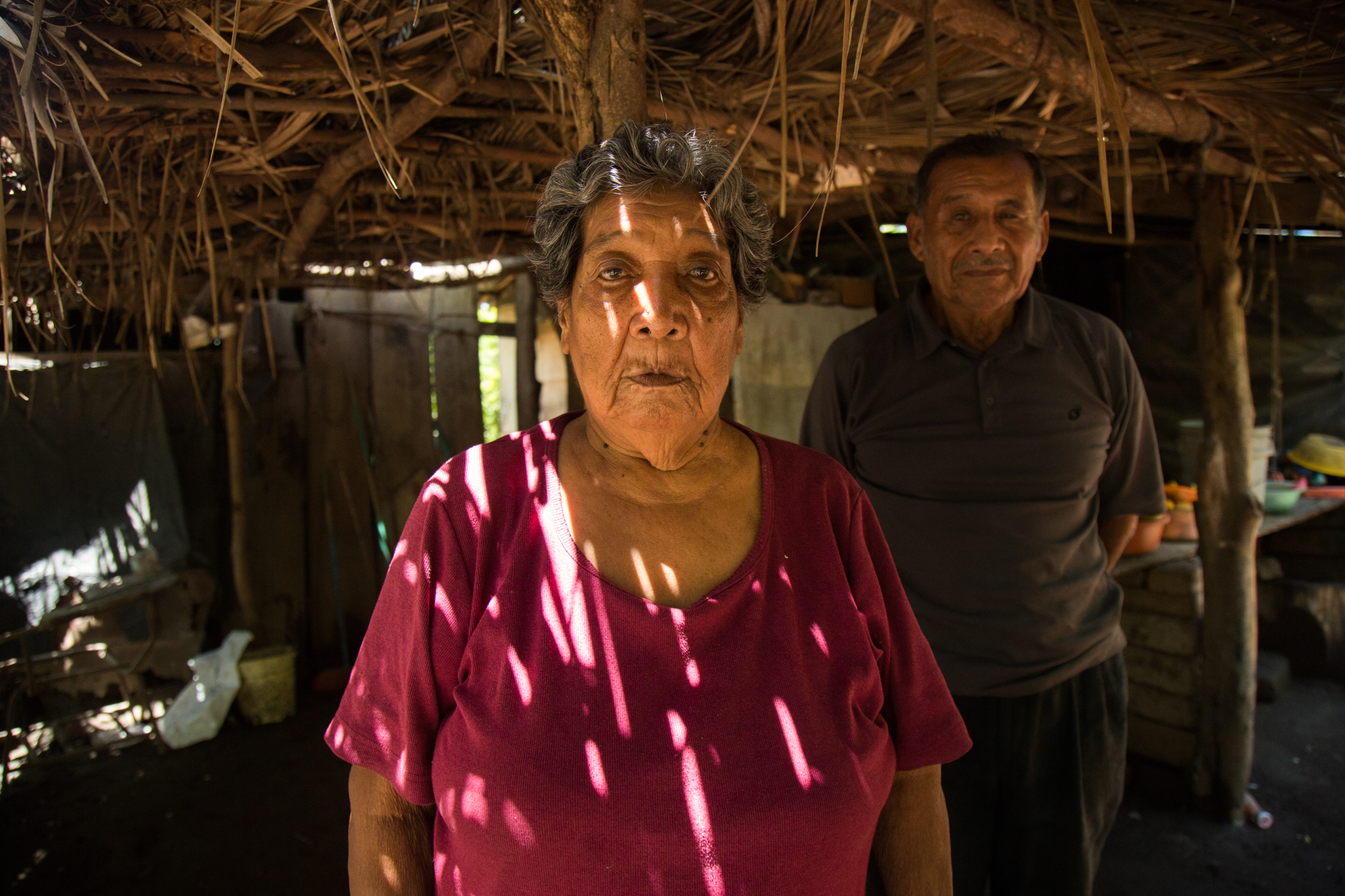 Egdomilia Mora Hernandez at home with her husband. A native of Ometepe Island, she promises to defend her land to the death if the government forces her and her family off of it due to construction of the Interoceanic Canal.