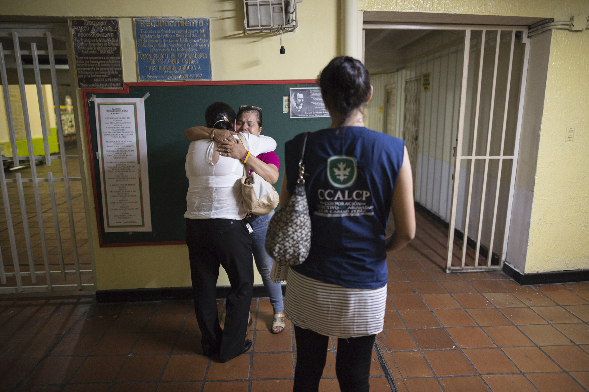 Julia Figueroa, human rights lawyer and leader of the CCALP, all women's legal collective, speaks with Imelda Oliva Martinez Reyes whose two children were disappeared, after a meeting at the Central Unitaria de Trabajadores in Bucaramanga, Colombia on May 8, 2017.