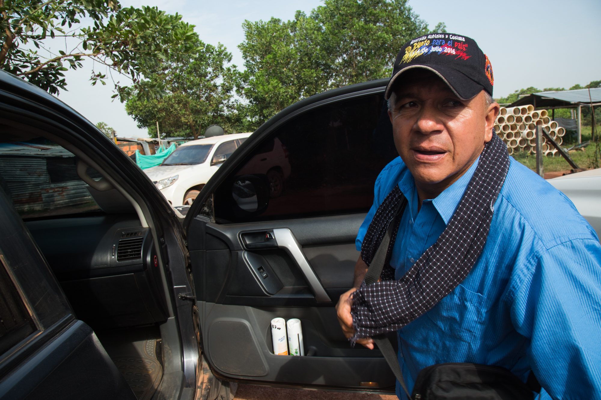Héctor Sánchez environmental and community defender steps into his vehicle, a bullet proof SUV driven by his body guard, protection measures provided by the Colombian state due to the threats against his life. Rubiales, Meta, Colombia. April 8, 2017