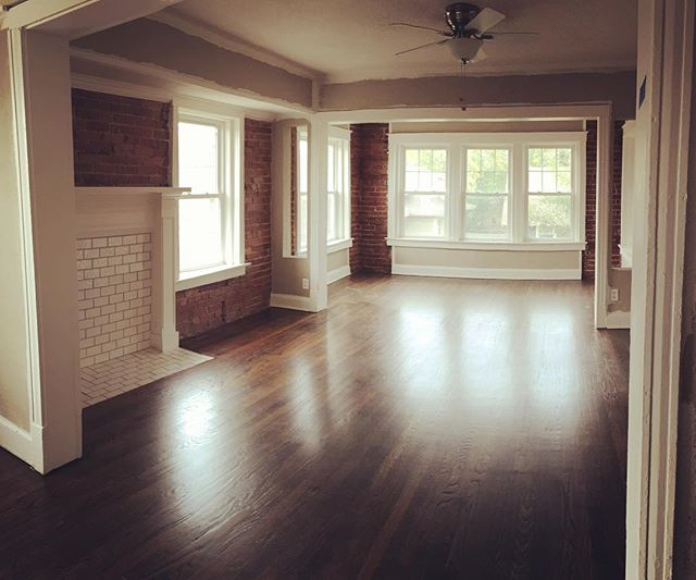 Walls are (mostly) Painter, floors are refinished, lights are up, cleaning is done... just a few finishing touches left!  What's not to love about this huge #livingroom with tons of natural light! #hexplex #historichydepark #renovate #exposedbrick #restore #kansascity #remodel #themaydailyproperties