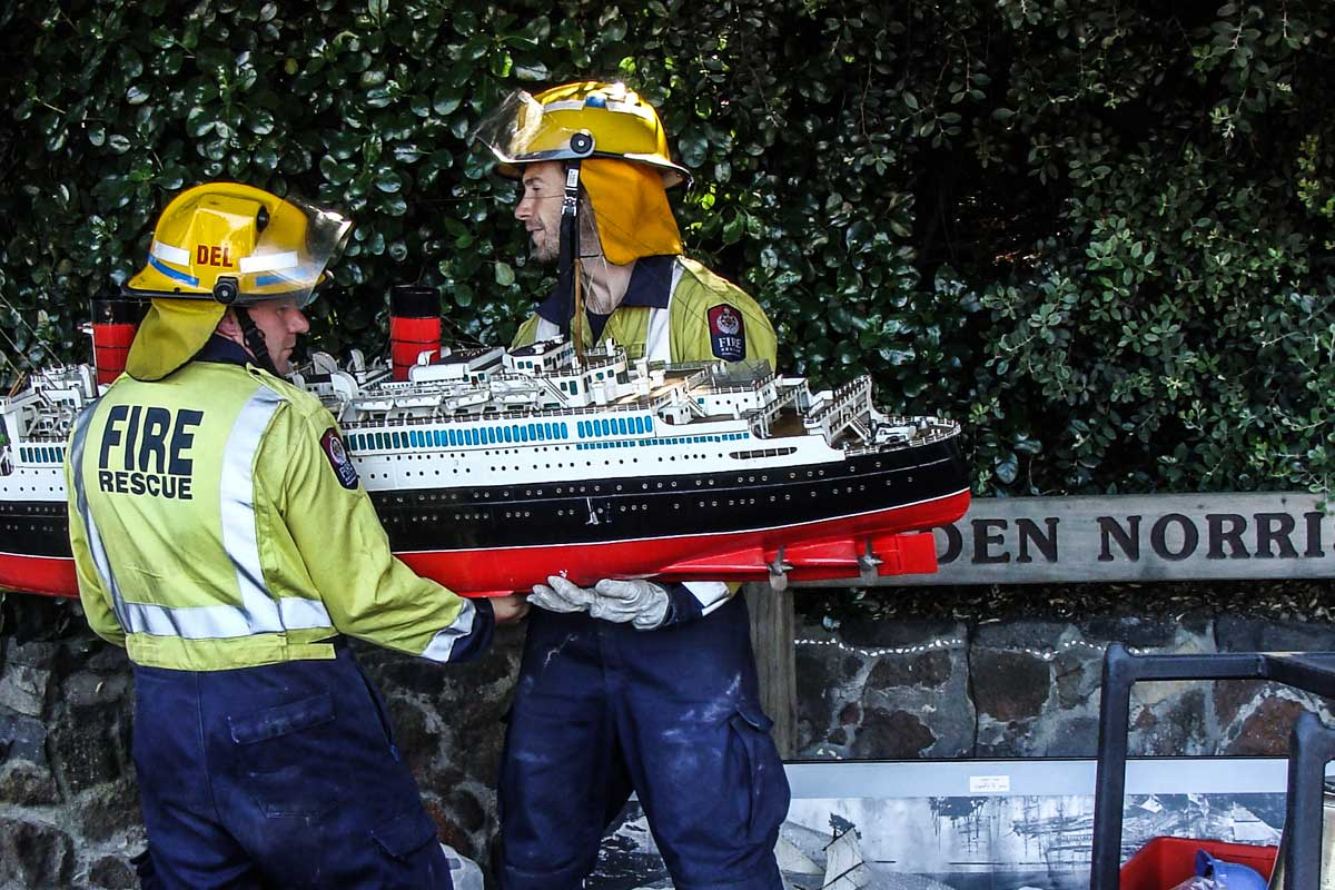 Members of the Lyttelton Volunteer Fire Brigade rescue collection items from 2 Gladstone Quay  c. Michael Davies