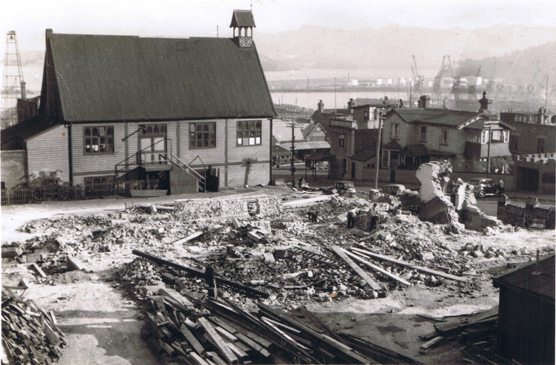 Lyttelton Distraic High School is demolished - Colonists' Hall still standing in the background
