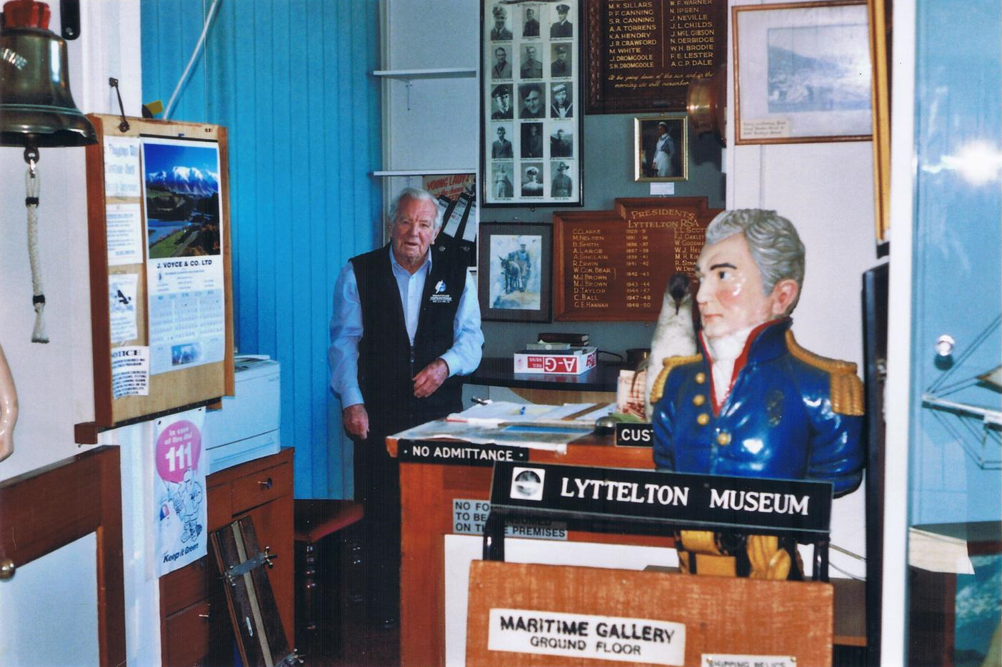 Baden Norris behind the desk at the Museum on Gladstone Quay. c. Lyttelton Museum collection