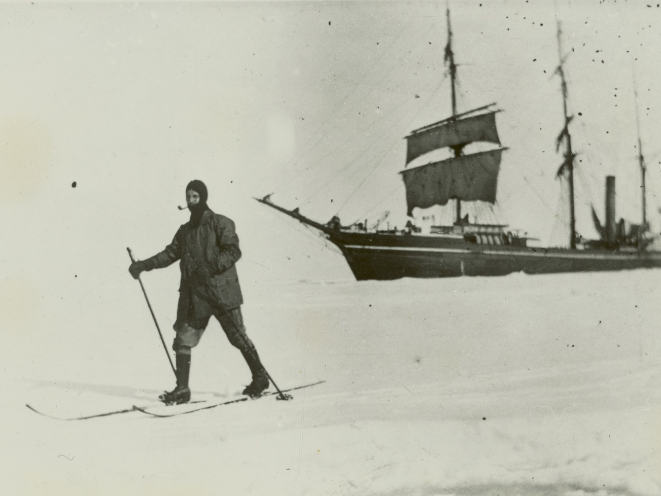 W.A. Horton, Engineer on the Terra Nova, skiing in McMurdo Sound.  c. Lyttelton Museum collection