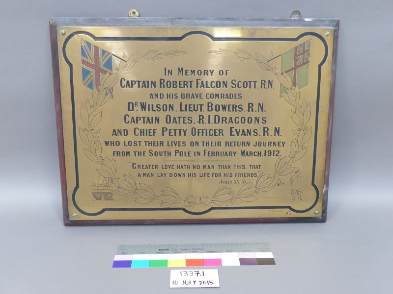 Brass plaque on a wooden background commemorating Captain Scott, Dr Wilson, Lieutenant Bowers, Captain Oates and Chief Petty Officer Evans. The plaque was in the building when the Museum moved in, per Baden Norris.