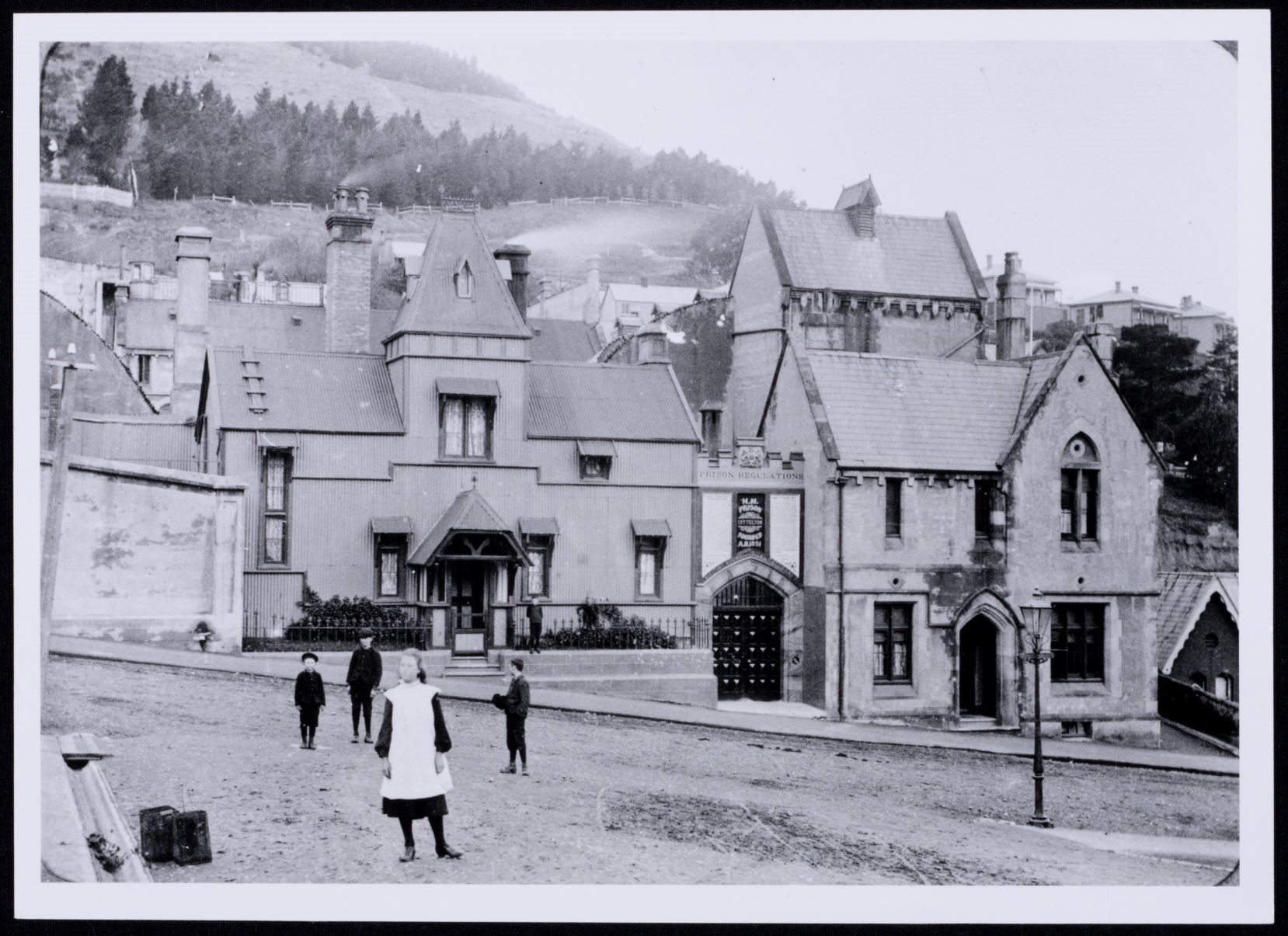 Lyttelton Gaol from the corner of Oxford and Winchester Streets, about 1900, Palliser family collection, Canterbury Museum, 1991.345.3