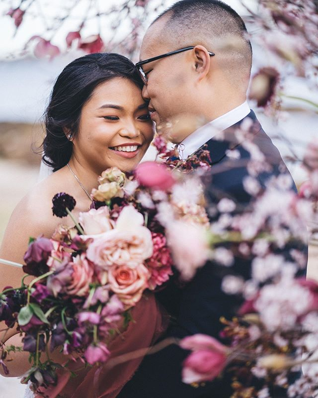 I was chatting to my friend @rpmarryme this morning about the beauty of walking into a wedding and realising through the day that you get to work with your friends and basically the best people in the industry on top of photographing these wonderful and completely smitten lovers (I mean, look how adorable they are here surrounded by @trillefloral cherry blossom floral creations😍). Days like these = simply too good to be true 🙌🏻✨✨ Florals by @trillefloral | Ceremony by @rpmarryme | Make up and hair by @amychanhairmakeup | Cinematography by @anchoredcinema | Bridal gown by @maggiesotterodesigns