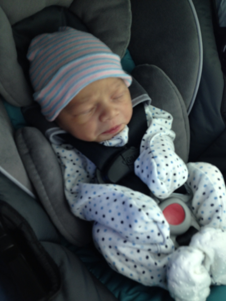 Tiny baby in a big onesie, and even bigger car seat.Almost hard to believe he was ever that tiny.