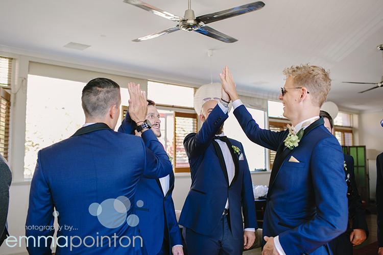 Groomsmen high five