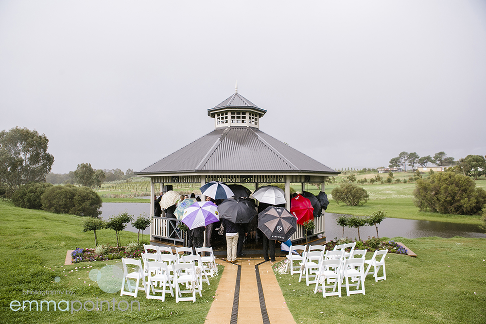 Guests making good use of umbrellas and the pavilion at Sittella Winery