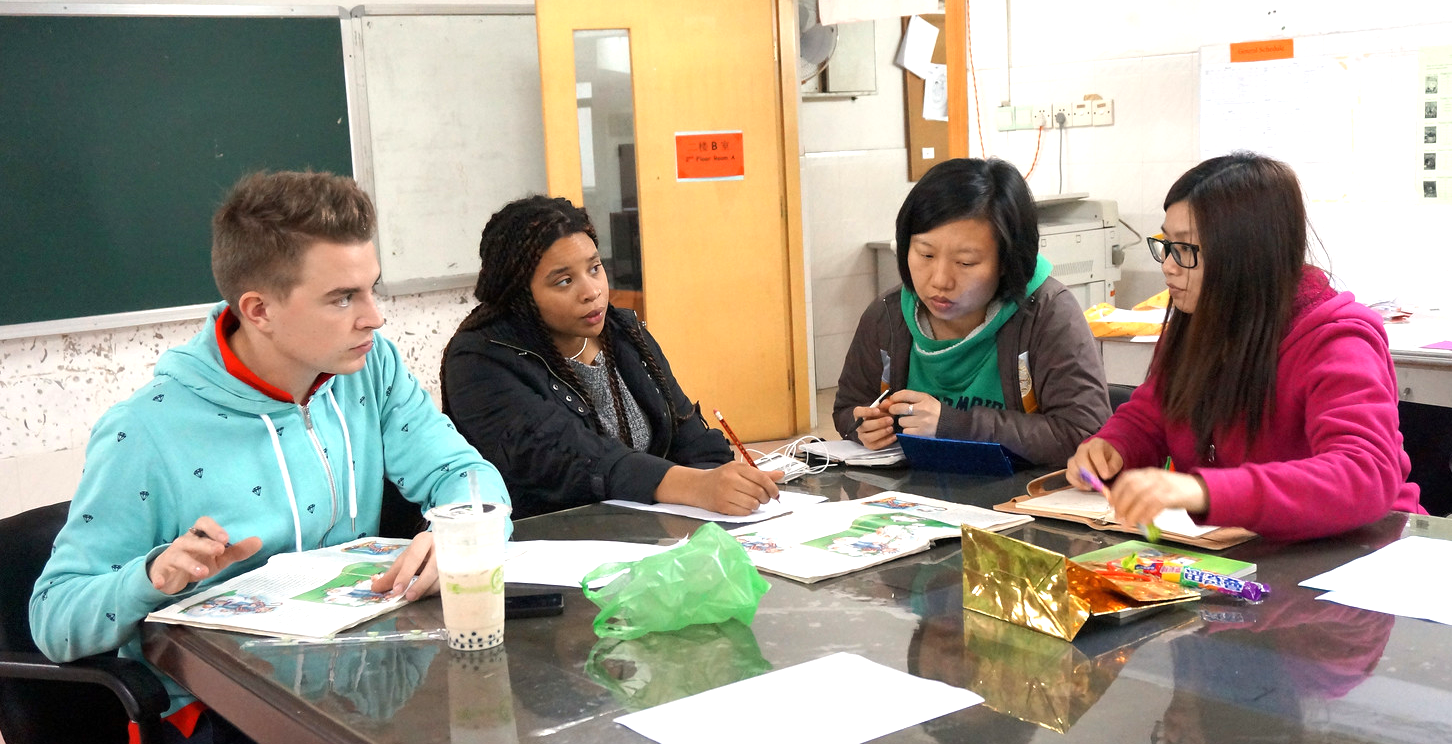 Teachers consult with their partner Teaching Assistants
