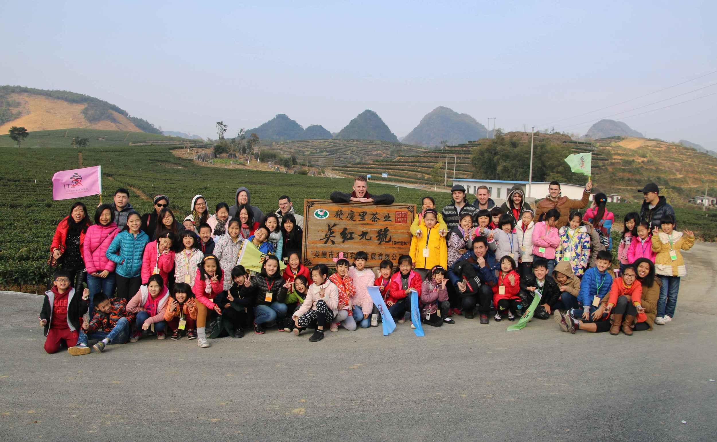 Group photo tea farm.JPG