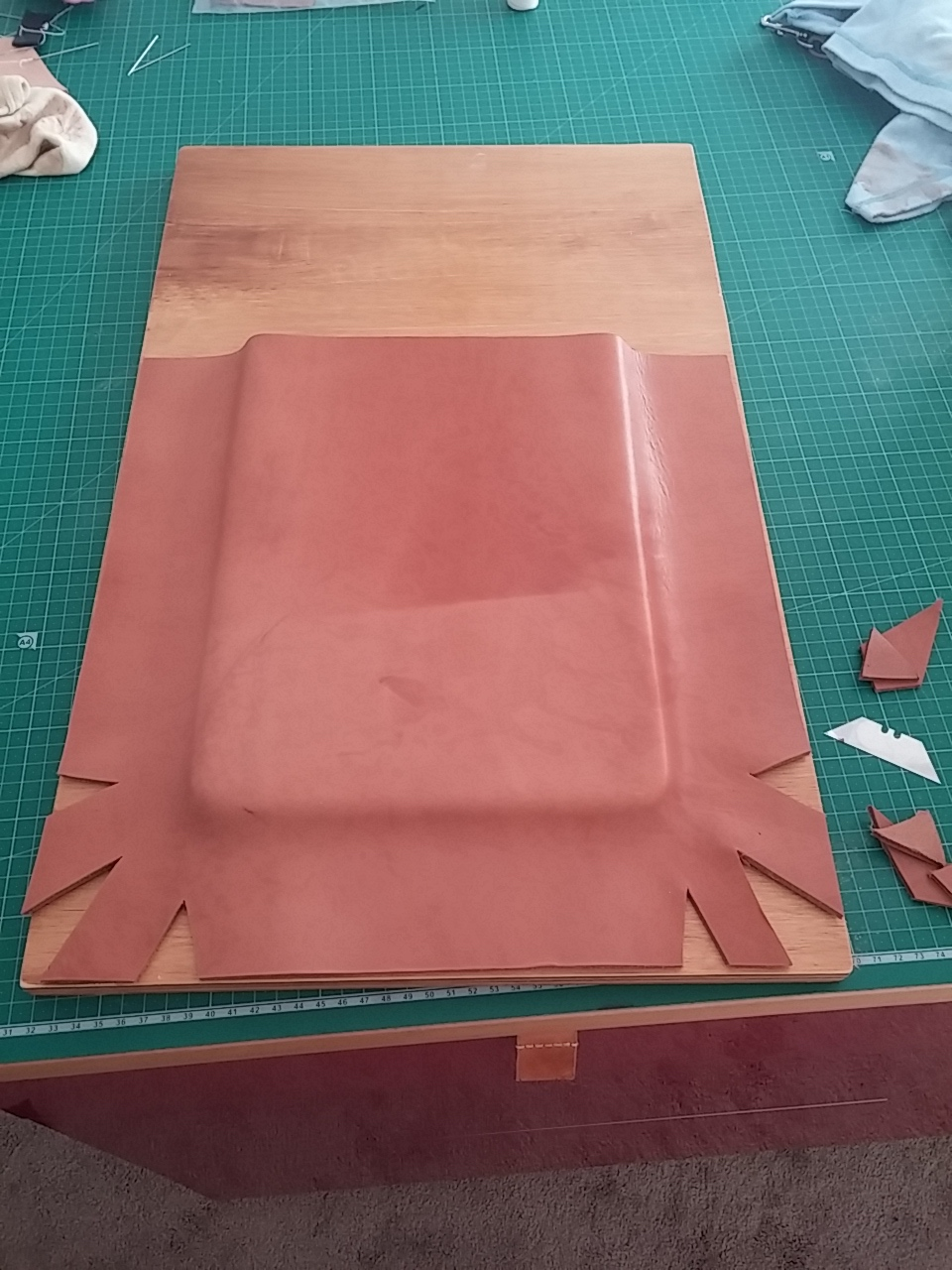 Moulding the leather with strategically placed 'V' cut