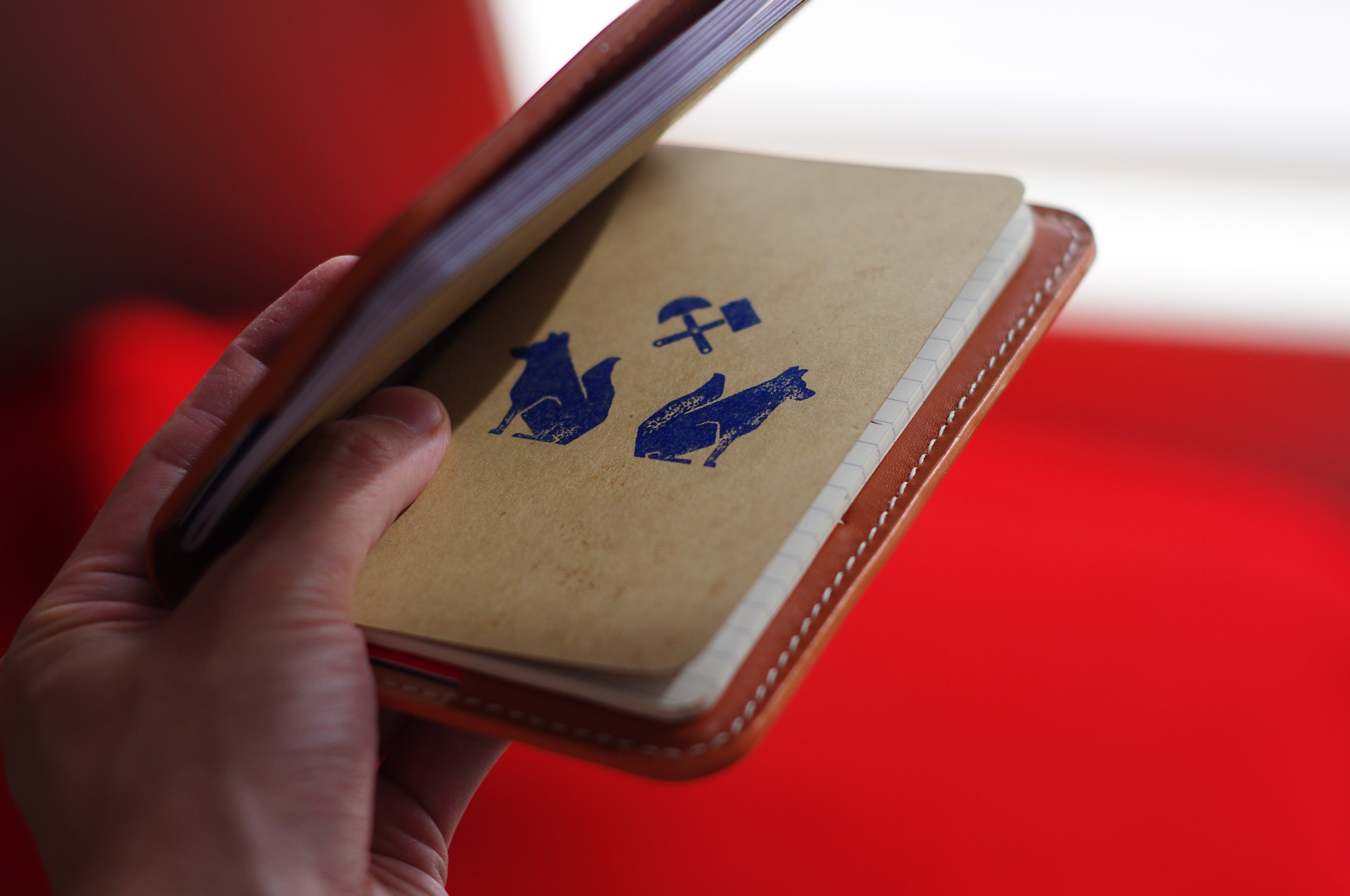 Moleskine Notebooks with our logo stamped