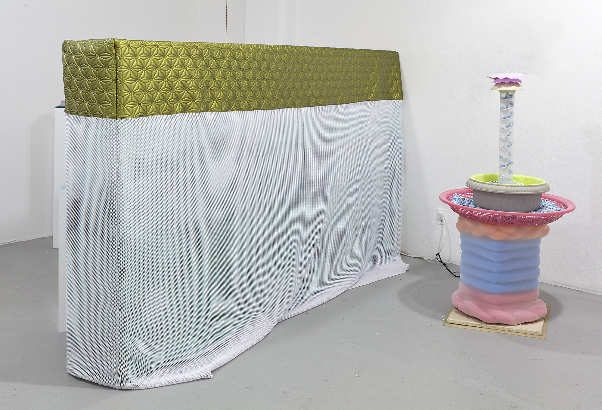 Fountain of Your Youth  with  Hedge  (2017, spacer mesh, toaster oven cover material, canvas, paint, lamps) as installed in  Tenderheaded  solo exhibition at Rush Gallery, 2017. photo: Martin Parsekian