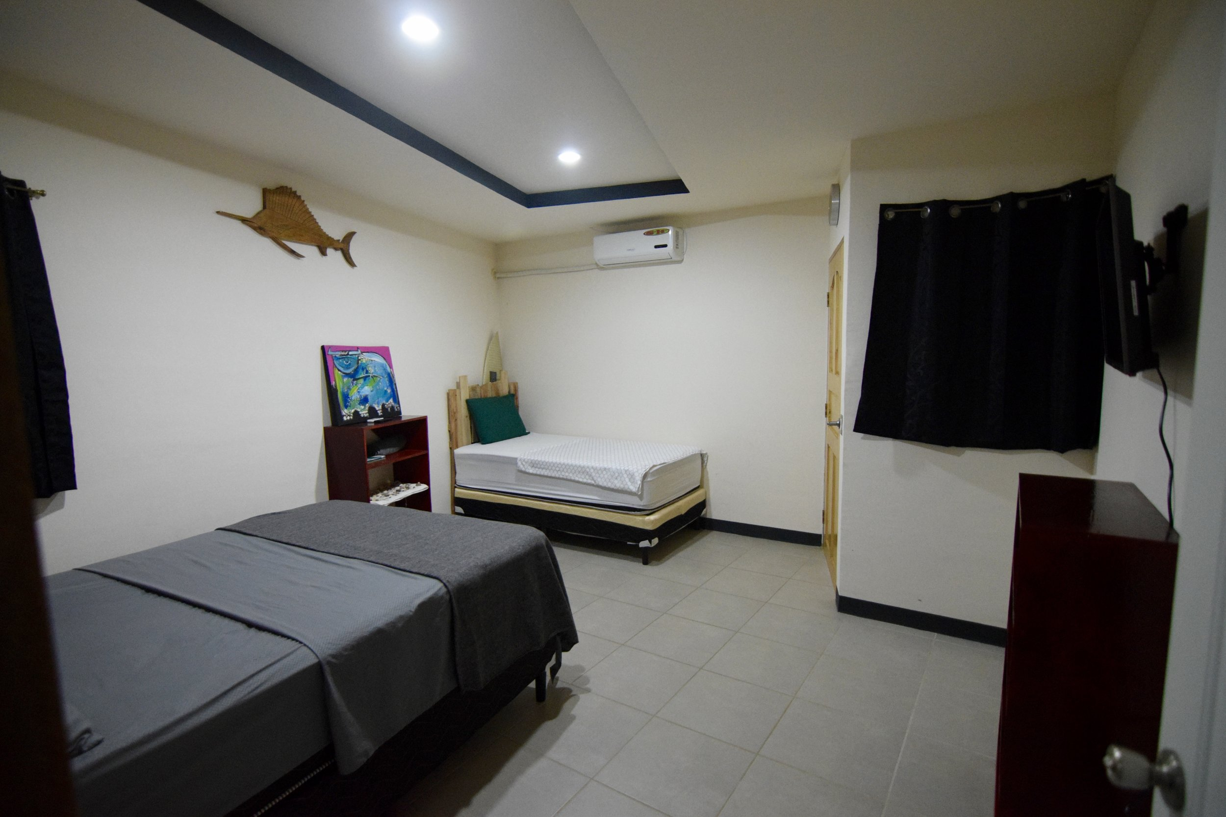 our large size rooms- EQUIPPED with queen and a single bed.