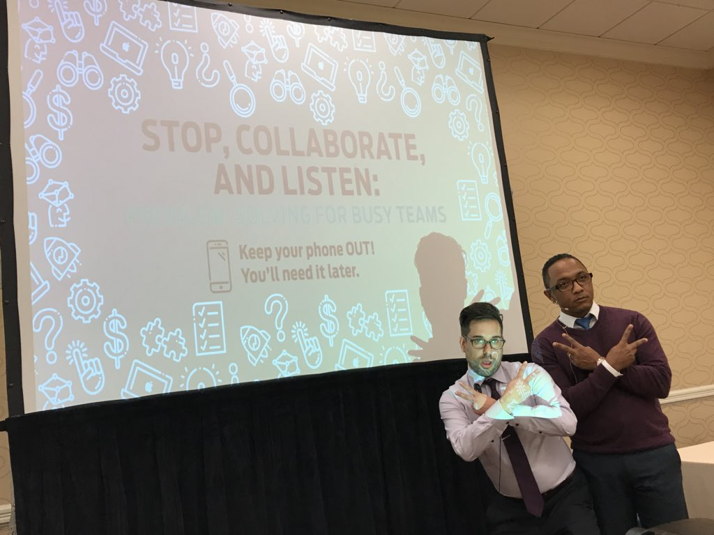 "Mark Banks (right) and Aaron Clay (left) psyching up the crowd before their session, ""Stop, Collaborate, and Listen: Problem Solving for Busy Teams"" at the 2018 Gathering of Games. Photo credit: Timo Kaapke."