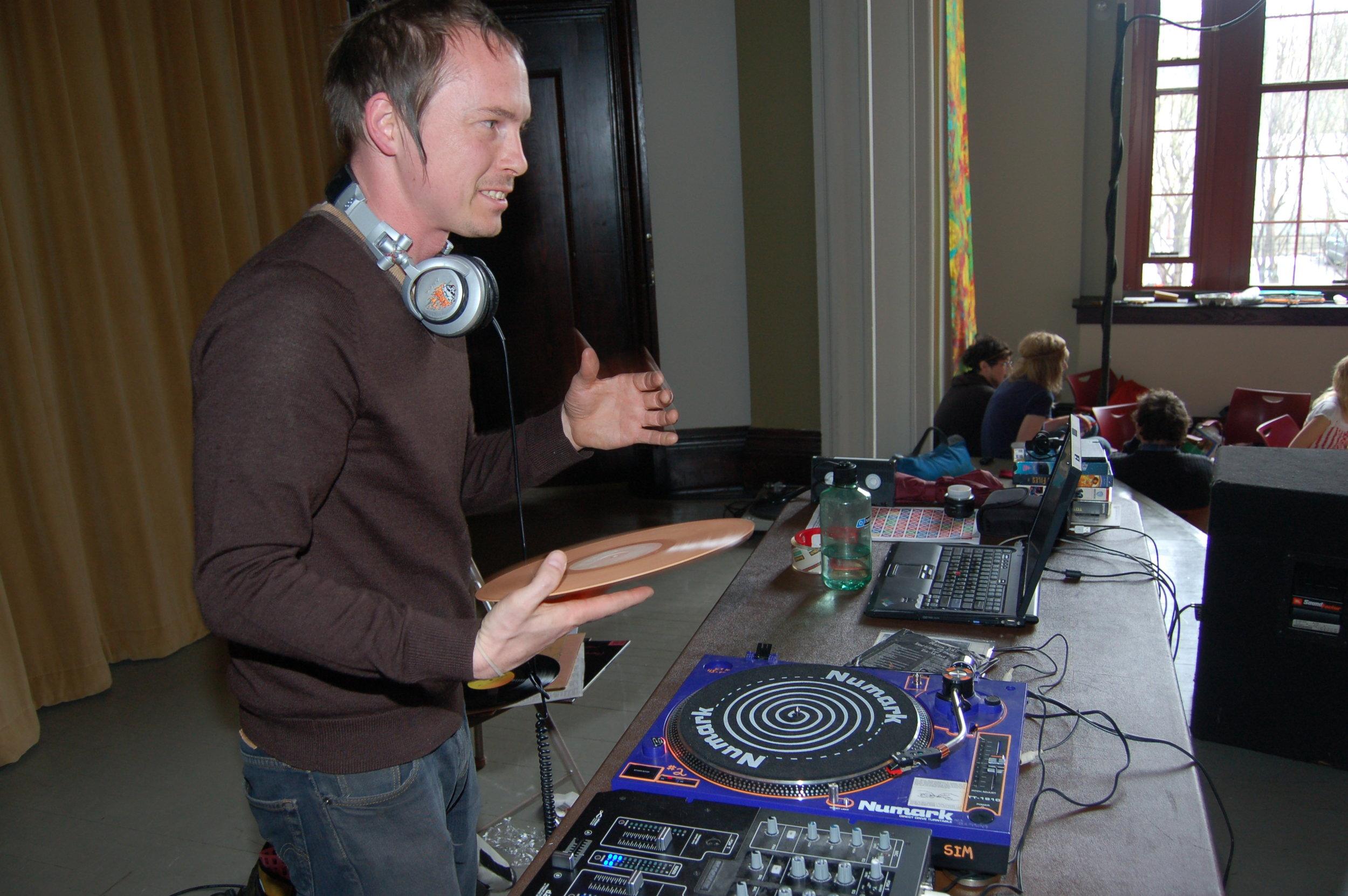 Above: Mark from Neptune on the DJ decks