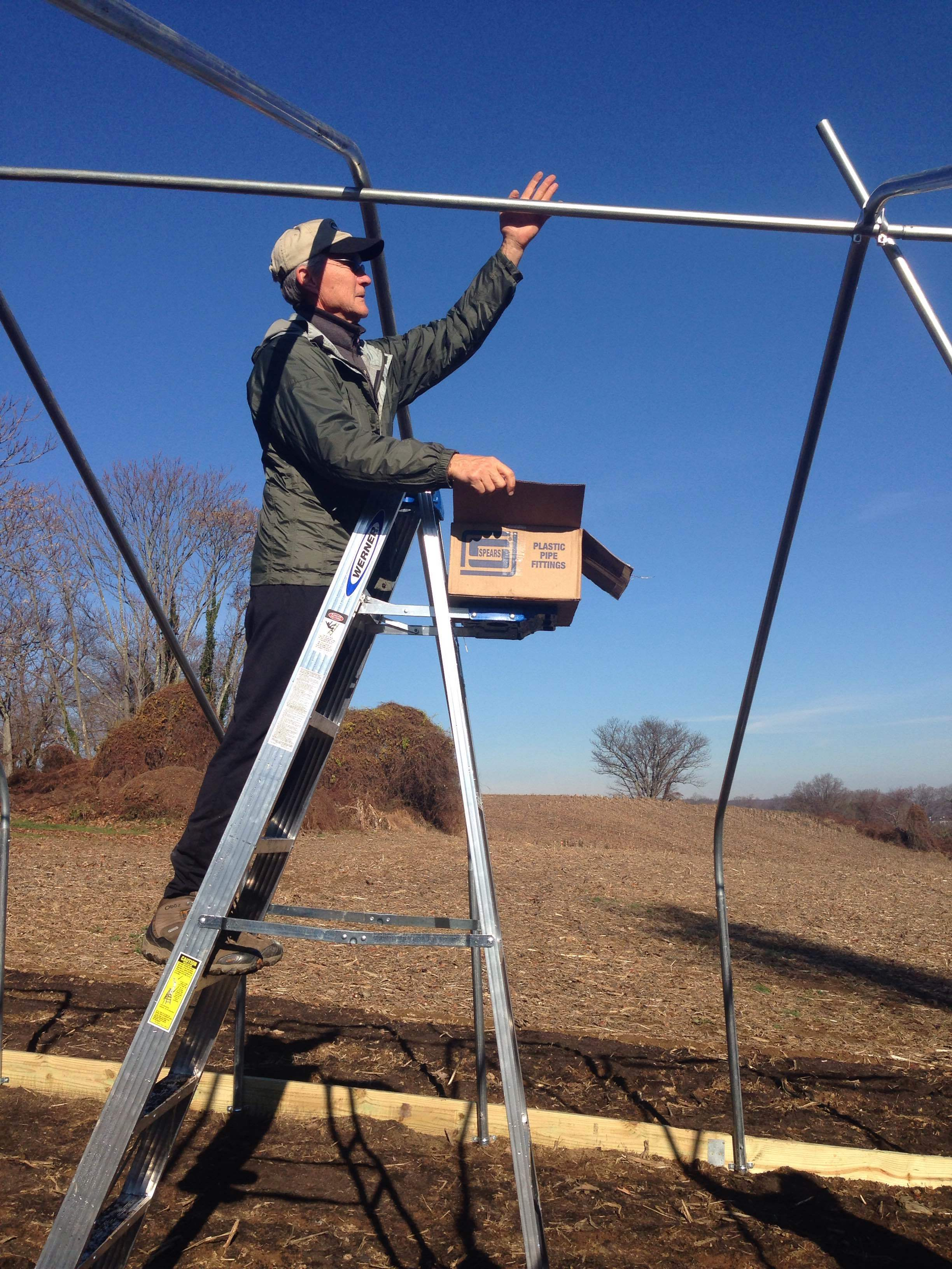 Dennis of Greenstone Fields hopped up on the ladder right away. He knew what he was doing, too!