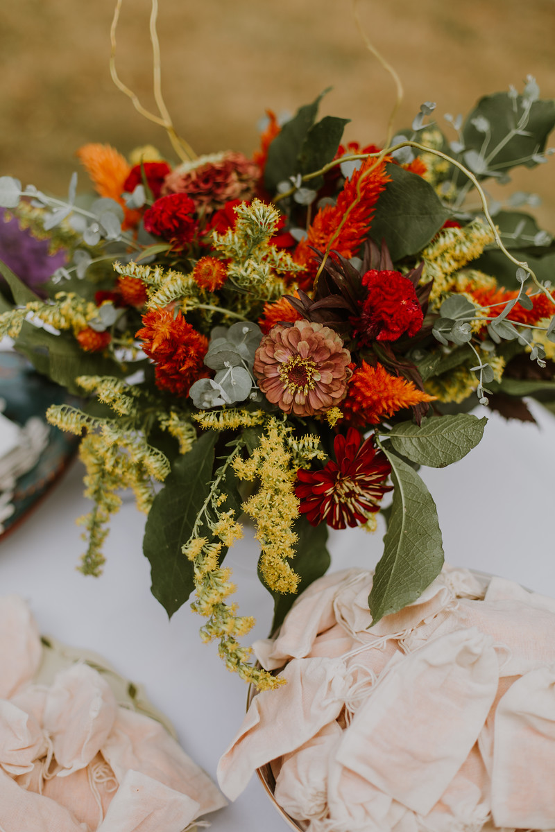 Centerpiece at the ceremony welcome table, surrounded by marigold petals in little pouches