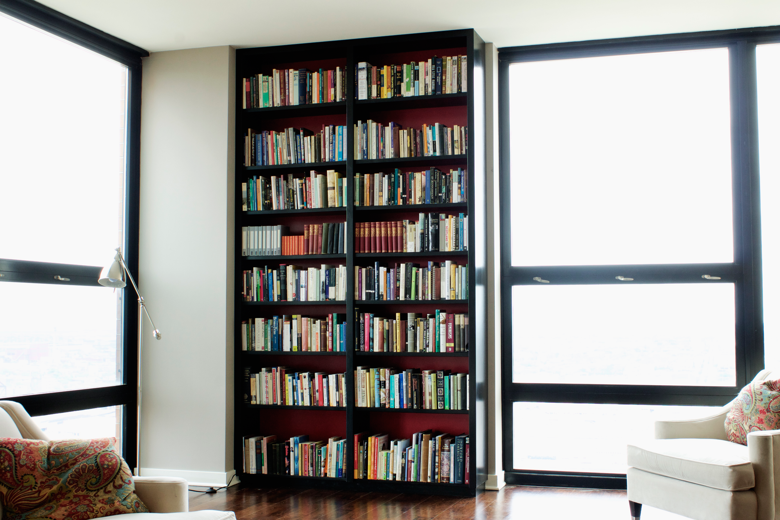 Floor-to-Ceiling Bookcases with Color Accent