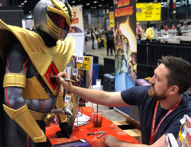 Joey getting his costume signed at a comic convention
