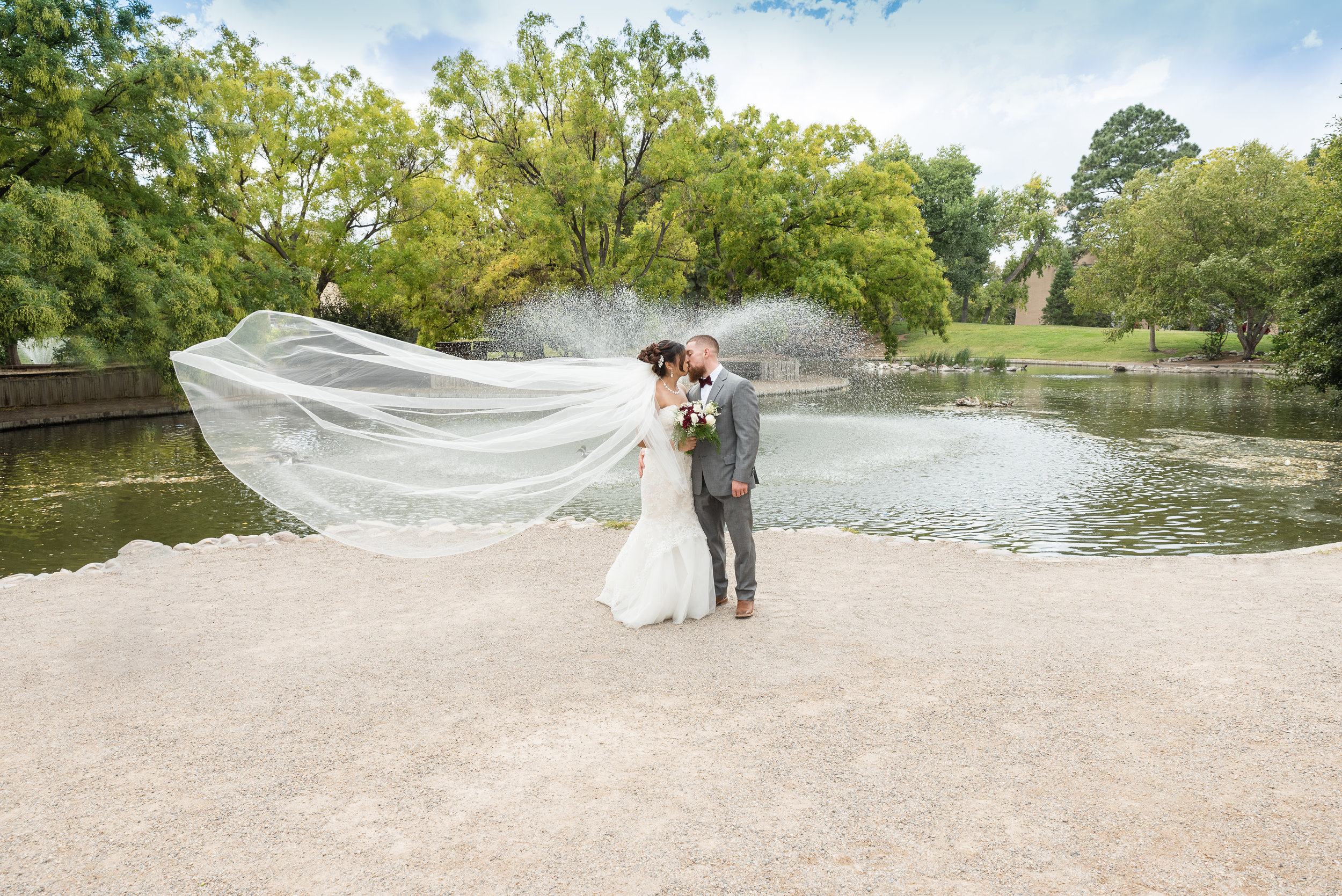 Albuquerque Wedding Photographer Frank and Julia Martinez at the UNM duck pond.jpg