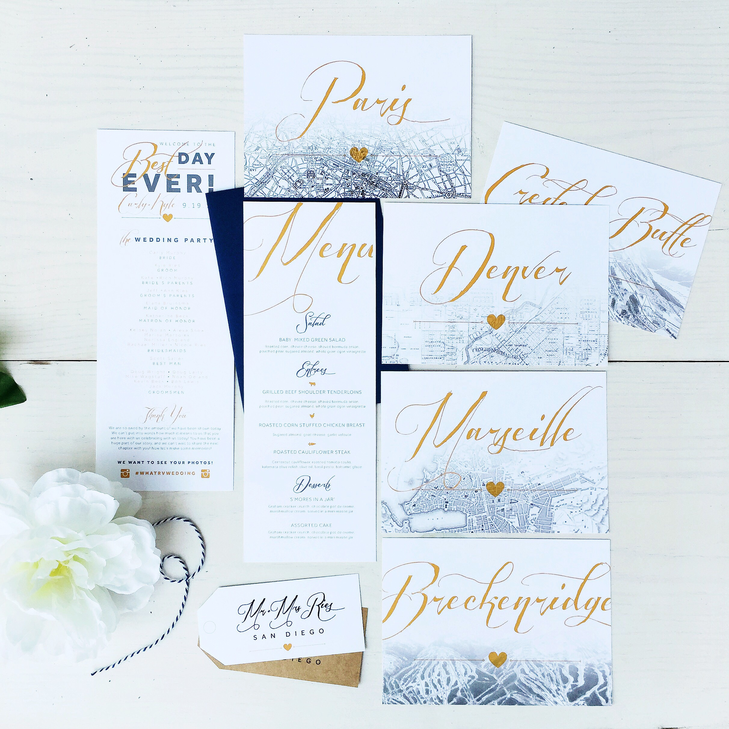 Travel themed custom wedding day details: Table numbers, reception menu, and ceremony program