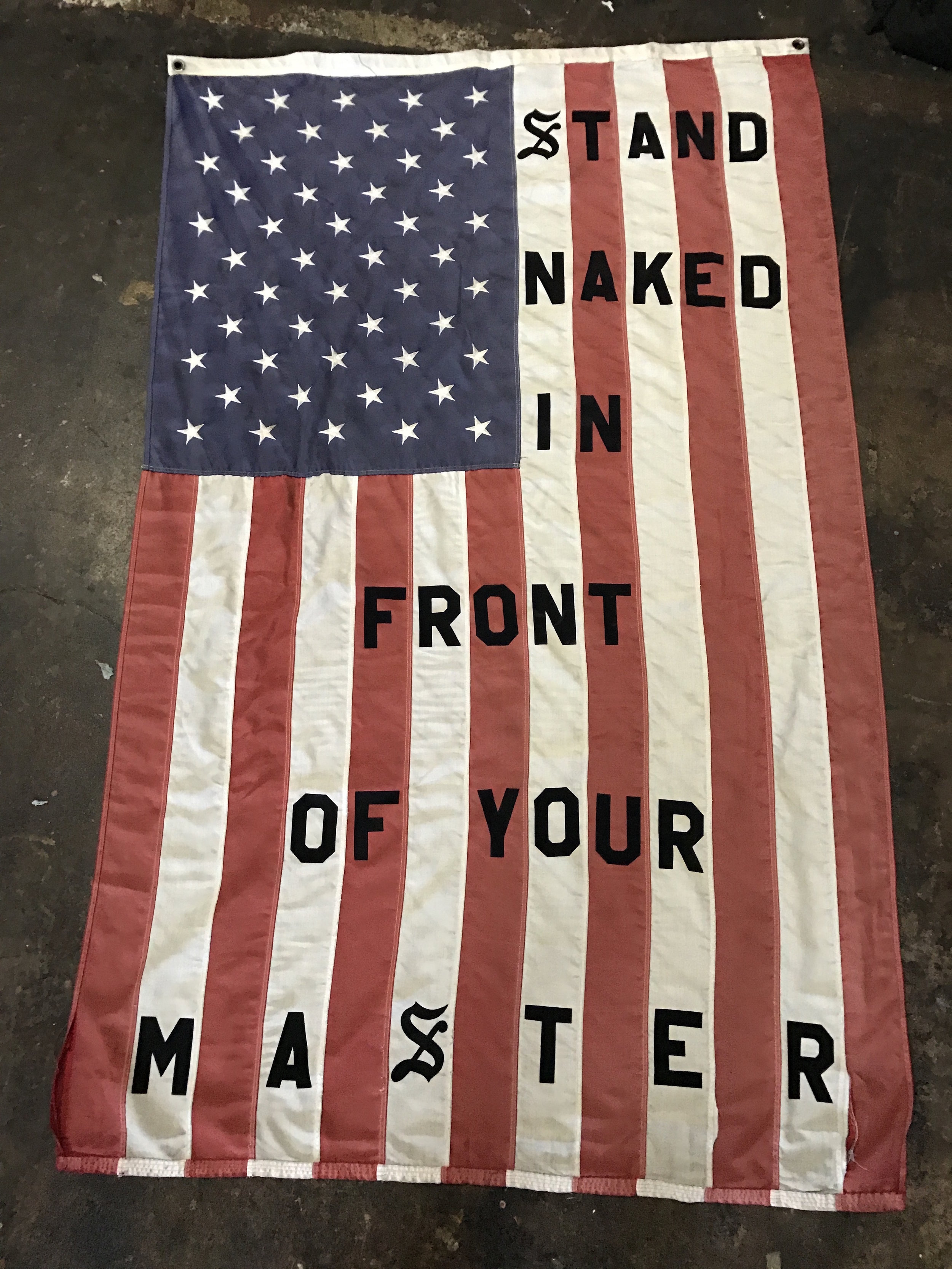 Cali Thornhill DeWitt, Stand Naked in Front of Your Master, 2017, cloth flag with felt lettering, 72 x 48 inches  Courtesy of V1 Gallery, Copenhagen.