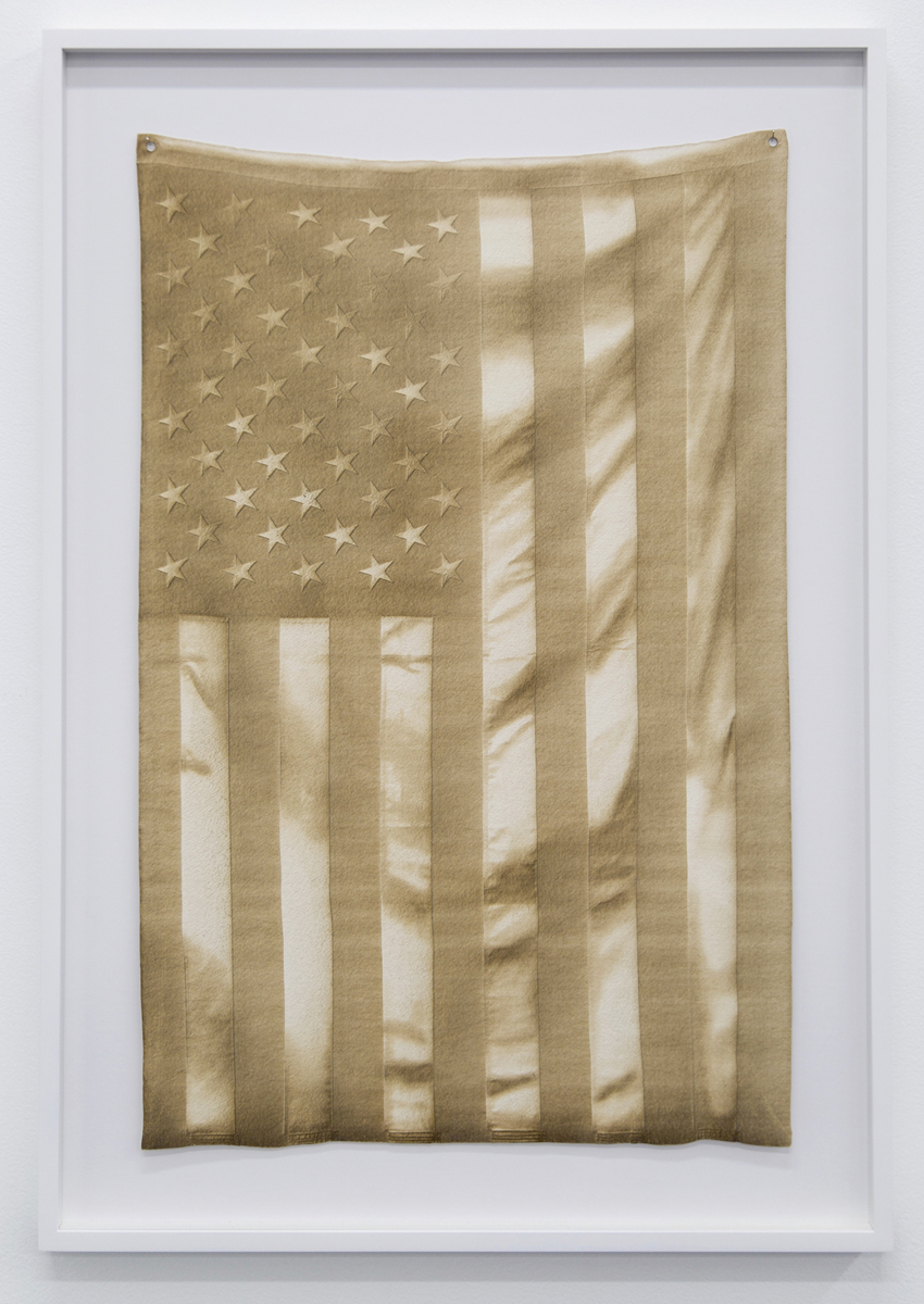 Joe Nanashe, Untitled (Burned Flag), 2016, laser etched paper, 28x18 inches  Courtesy of  Victori + Mo , New York, NY