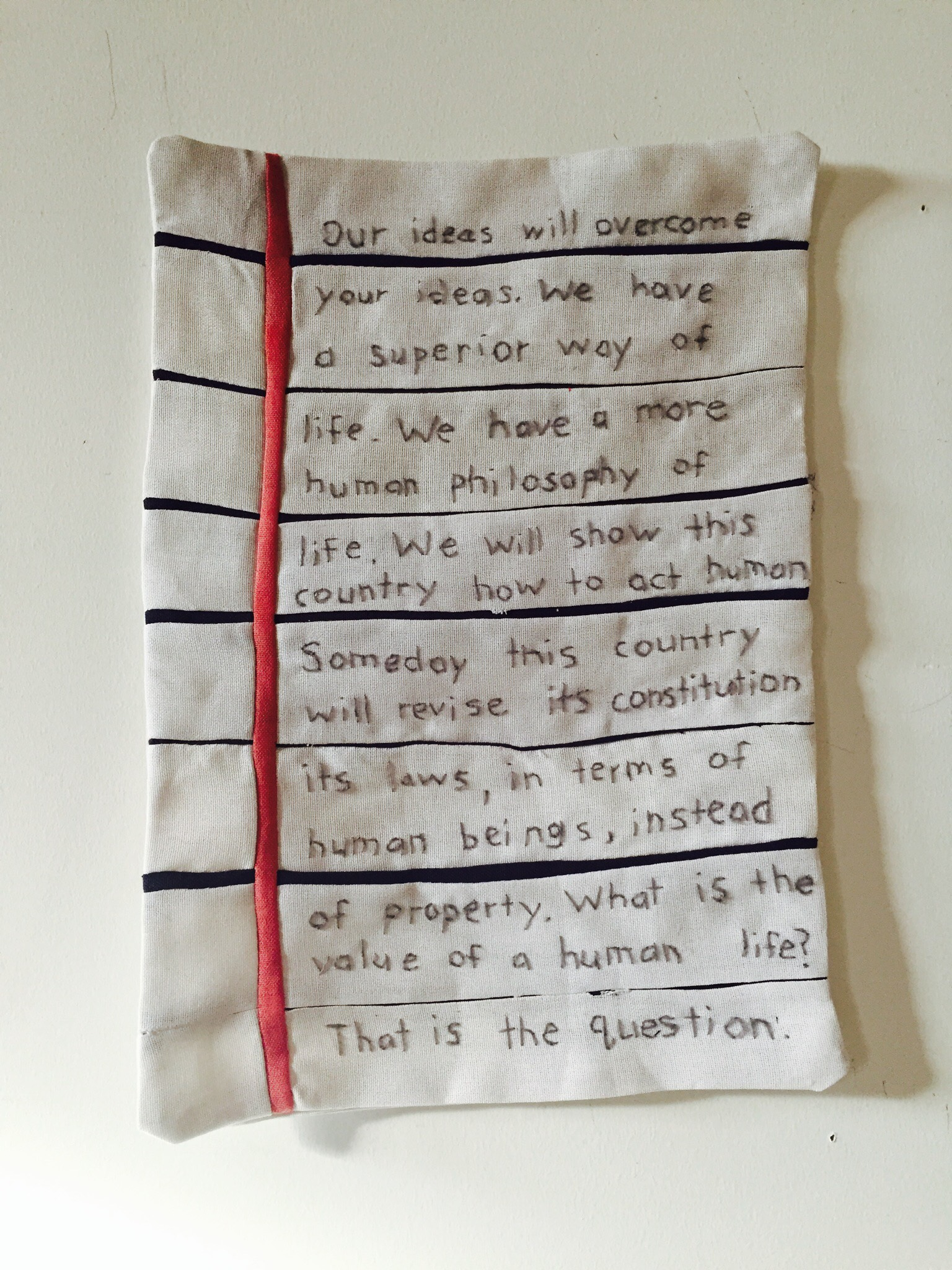 Megan Whitmarsh,1971/2017, American flag, embroidery thread and words by Vine Deloria Jr. circa 1971, 15 X 10 inches