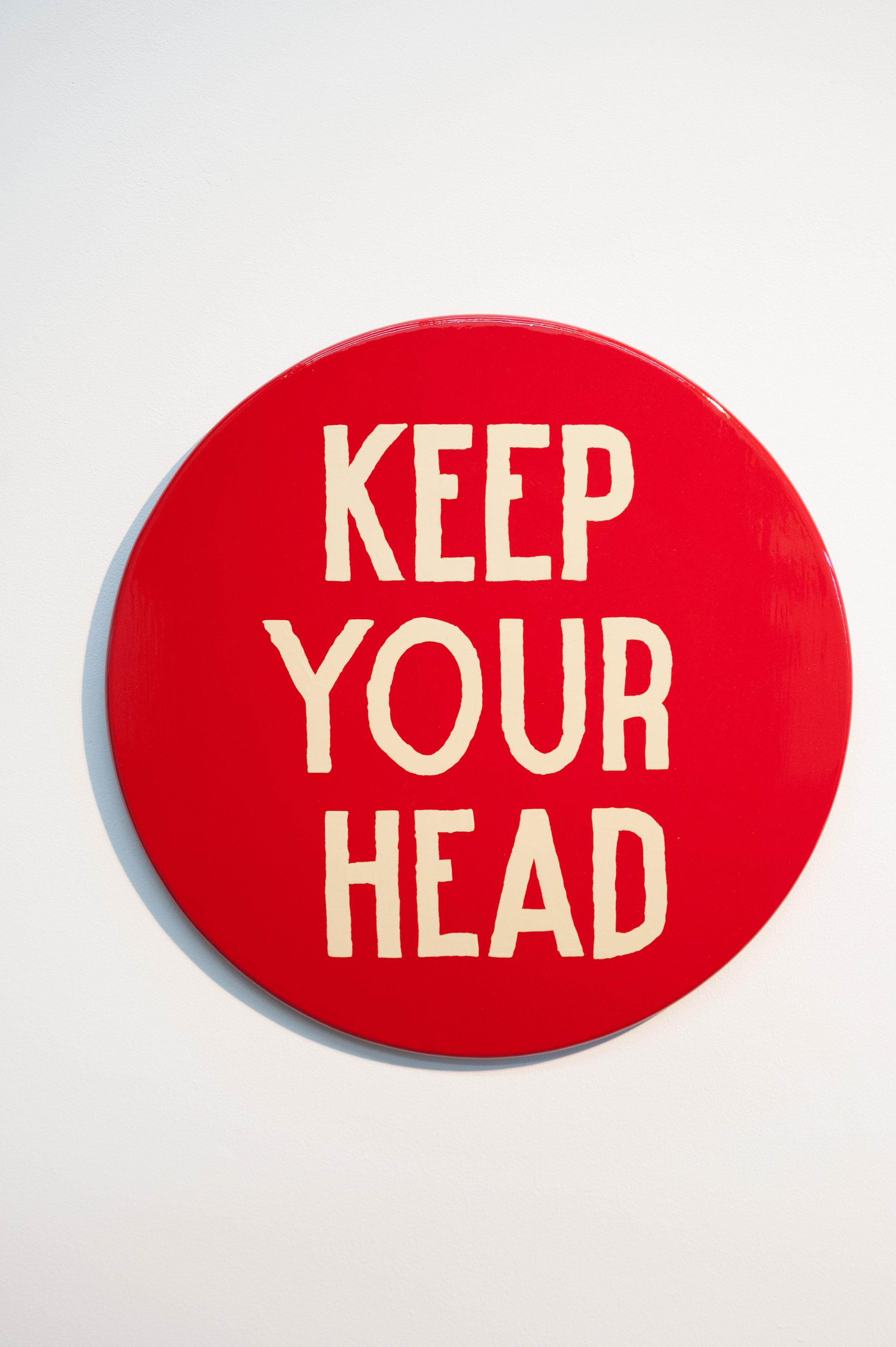 """Jim Christensen,KEEP YOUR HEAD, 2014, sign paint on pine, 18"""" diameter x 1"""" deep"""