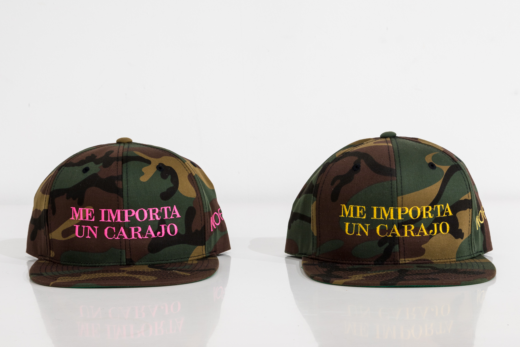 """""""ME IMPORTA UN CARAJO"""" CAMO HAT WITH GOLD OR PINK STITCHING $45"""