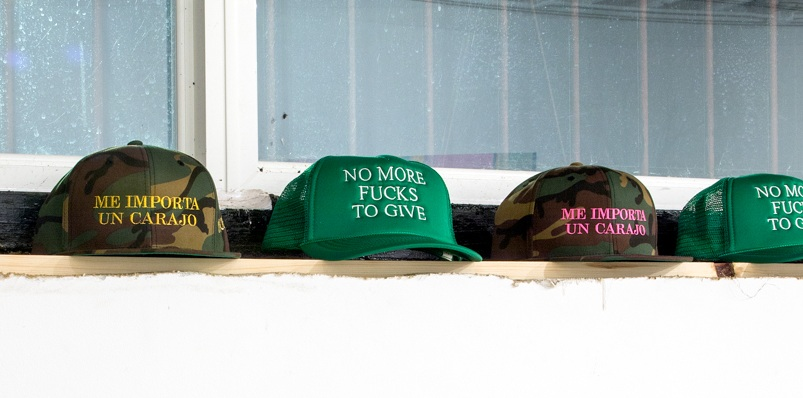 """""""NO MORE FUCKS TO GIVE"""" TRUCKER CAP IN KELLY GREEN WITH WHITE STITCHING $40  """"ME IMPORTA UN CARAJO"""" CAMO HAT WITH GOLD OR PINK STITCHING $45"""