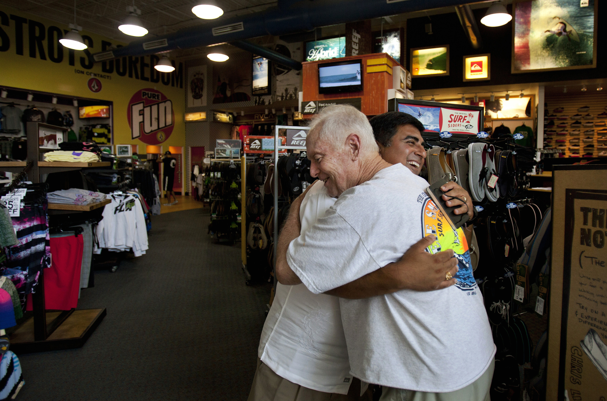 2011, Deepak Nachnani owner of Coastal Edge surf shops is widely regarded as the man responsible for the current boom of the East Coast Surfing Championships. Deepak gives long time local surf icon Pete Smith a hug inside the Coastal Edge surf shop.