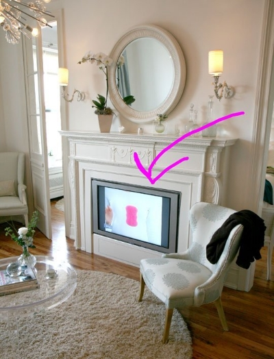 (7)  Hearth in Hiding  - Tuck away your flatscreen in your non-operational fireplace. Elegant function! For full tutorial via  Apartment Therapy , click  here .