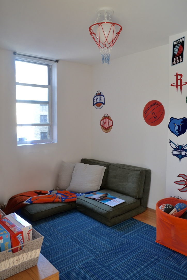 What little sportsnuts, huh? These kids clearly love their basketball! Hence the playroom theme. The two floor cushions pushed together act as a little love seat in the nook and can either fold or extend. Perfect for watching the game!