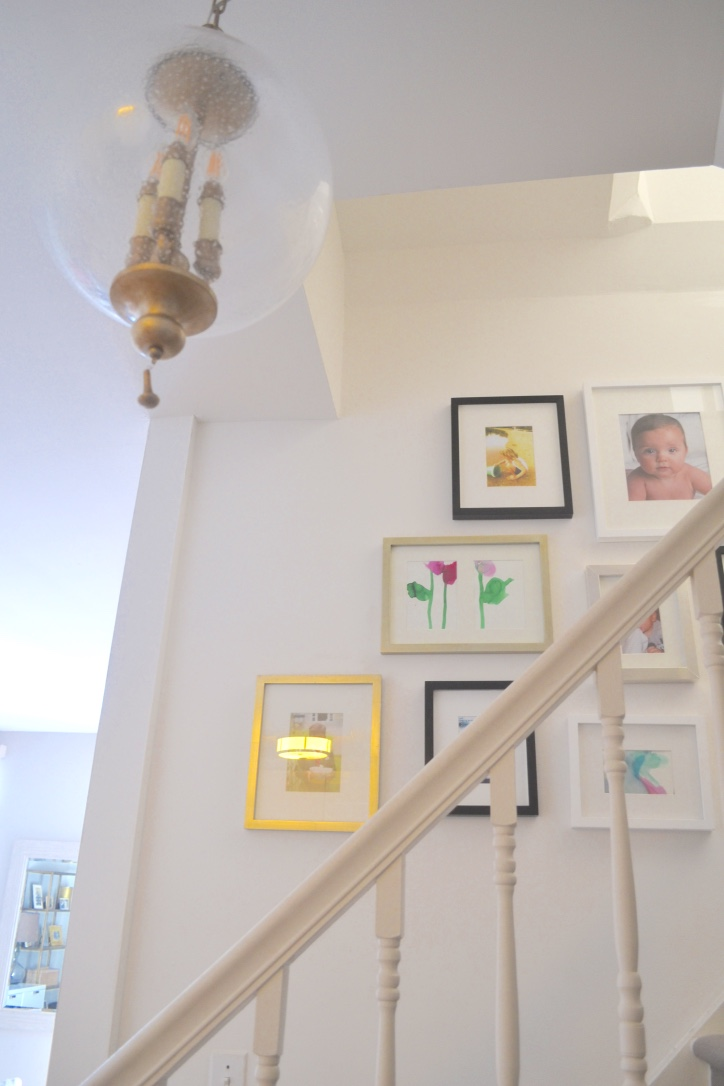 The best part of having a staircase? It's the ultimate excuse for a  gallery wall !