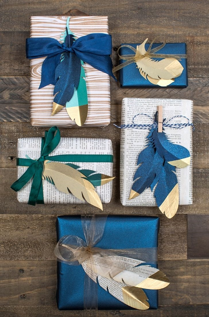 Gold Tipped Paper Feathers via Lia Griffith   (love this color palette!)