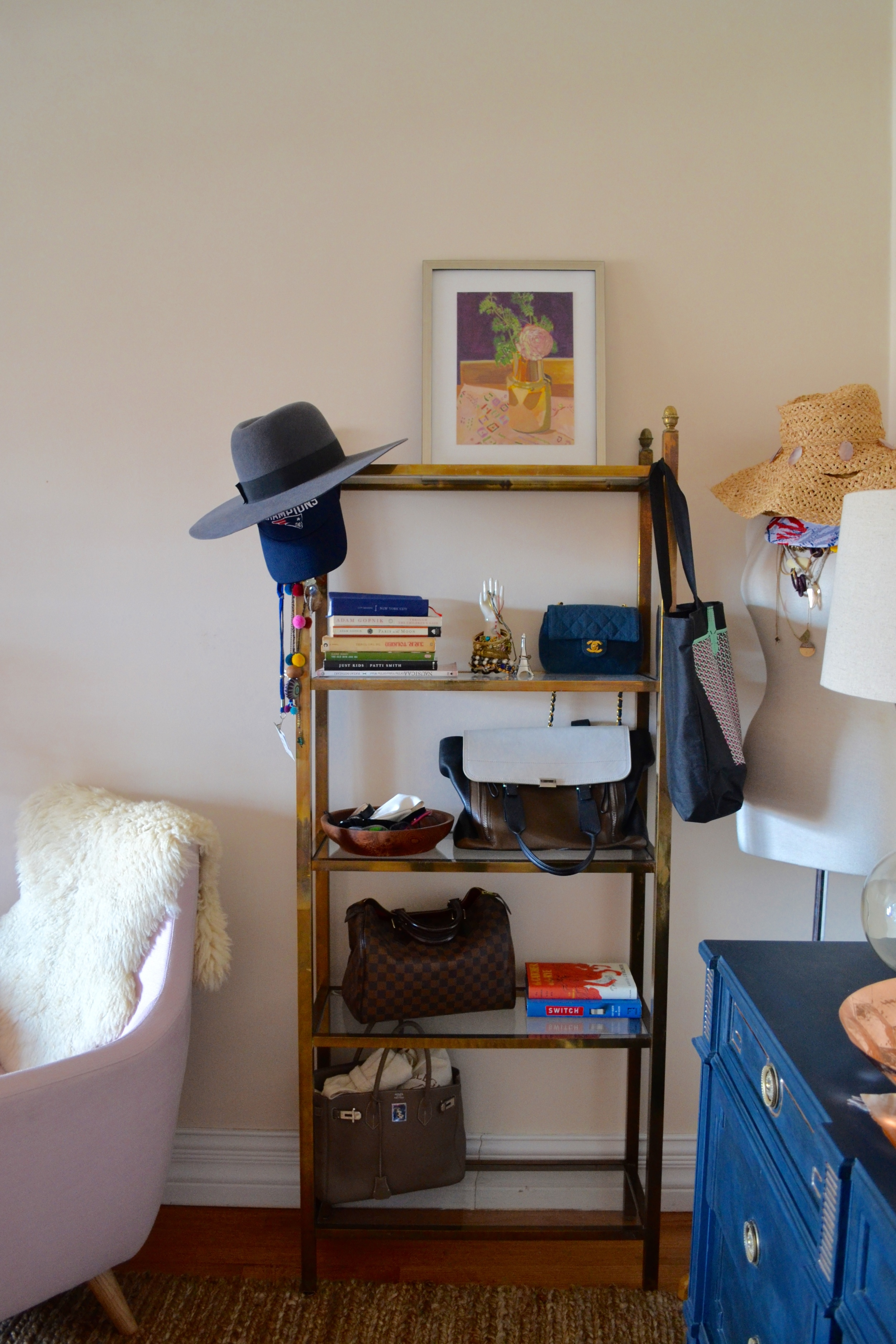 The brass etagere is a vintage find, along with some of the purses and accessories on display!