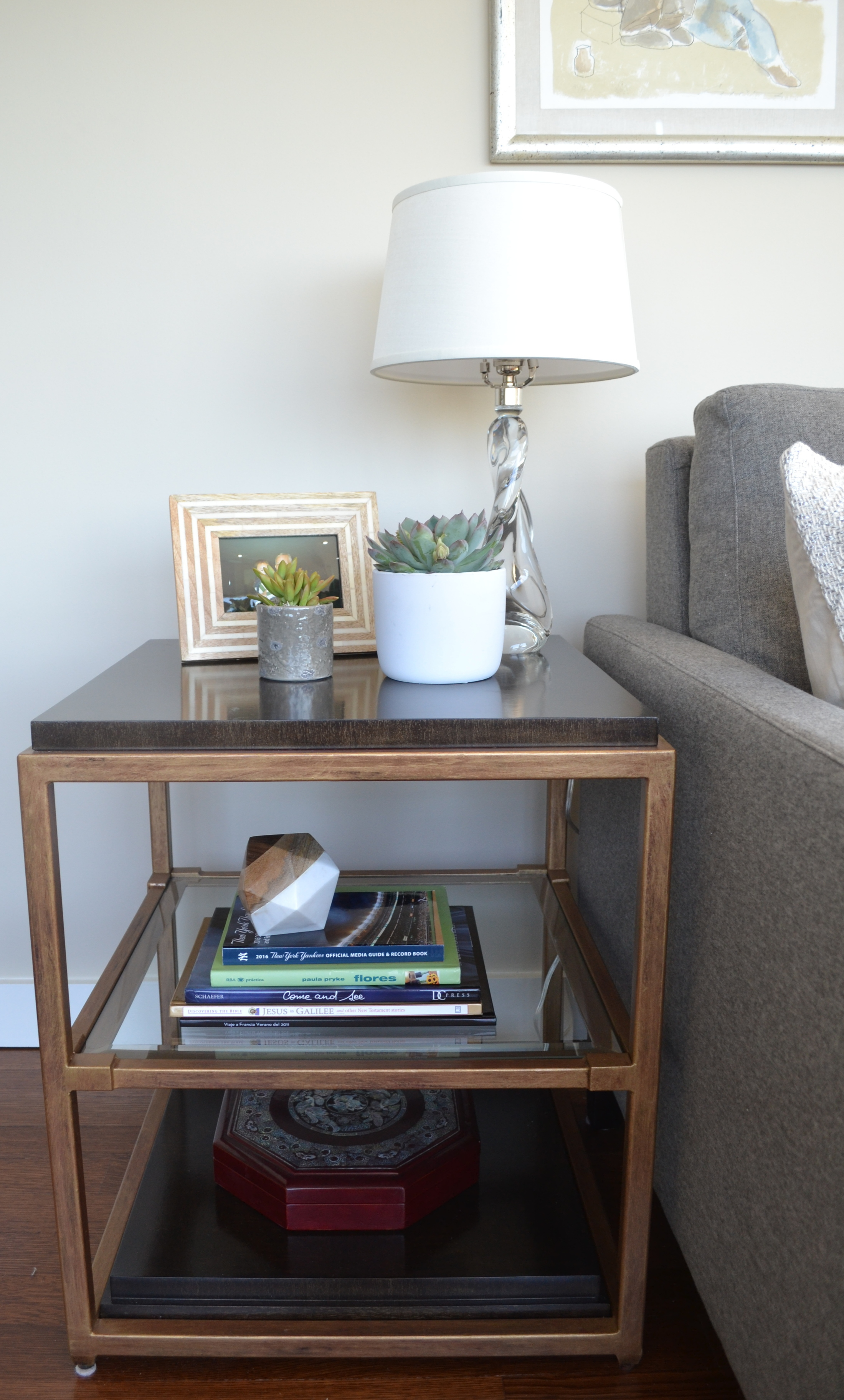 We loved the mix of brass, glass and wood on these end tables, and the fact that they had a shelf to provide additional storage.