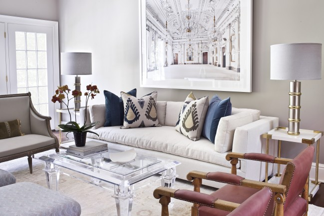Traditional Style Lucite Coffee Table in a Contemporary Eclectic Setting. Design by Carmina Roth Interiors.