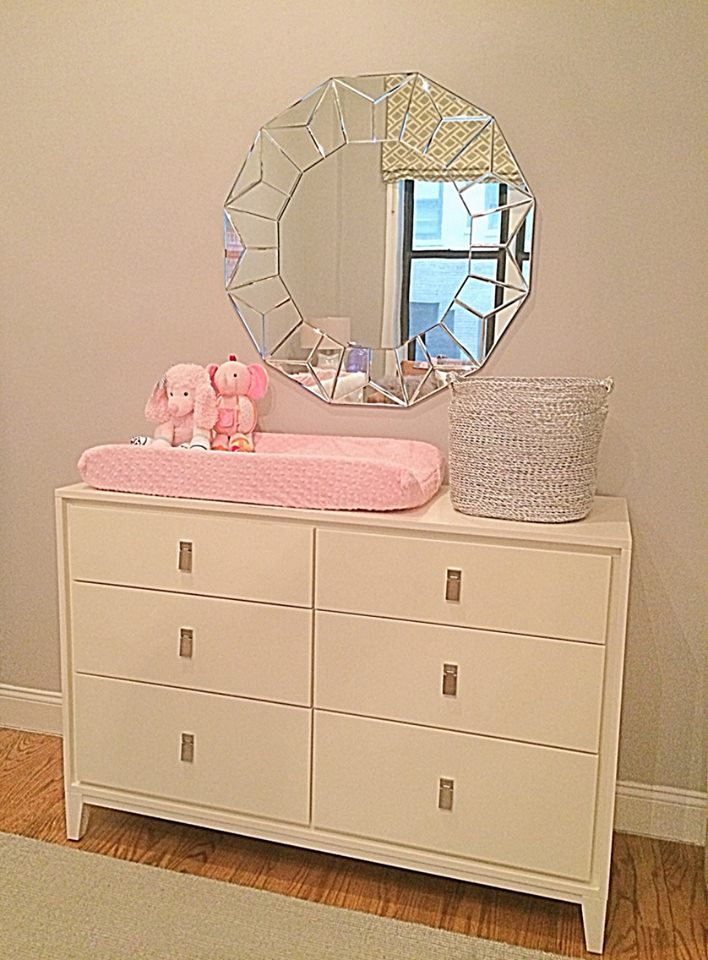 The West Elm dresser, changing pad, mirror and basket all came with.