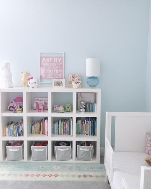 You may recognize this bookcase from the old nursery. We flipped it horizontally to provide easier access for Av to her toys and books, and now the top is more accessible for us adults. We also had the blue glass lamp from wayyy back in the day when the Brooklyn nursery was a man cave/office. #repurposing.